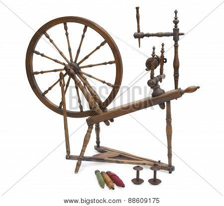 Antique Spinning Wheel With Yarn And Bobbins Isolated On White