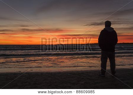 Silhouette Of Man On A Beautiful Sunset On The Beach