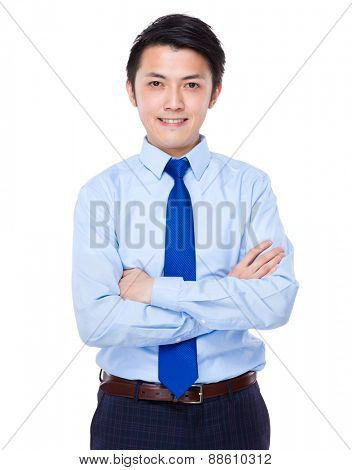 Young satisfied businessman with his arms crossed