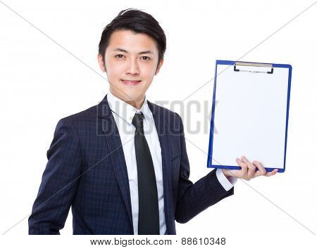 Businessman show the blank page on clipboard