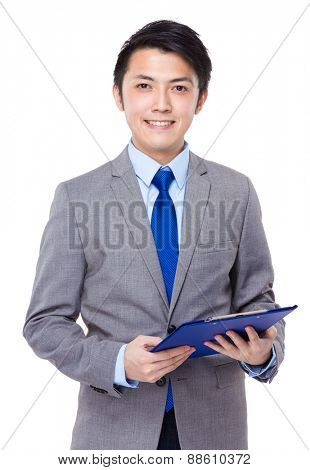 Young businessman with a folder