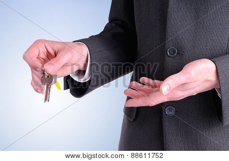 Half Lateral Body Commercial Agent With Keys In Hand Isolated