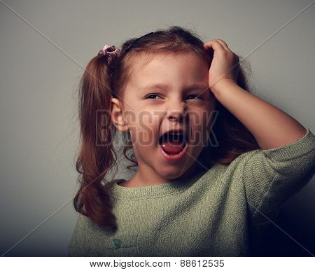 Crying Unhappy Girl With Open Mouth Holding Hand The Head On Dark