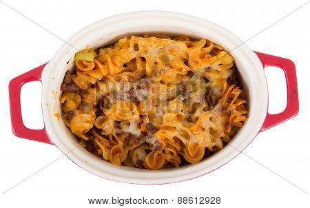 beef and cheese spiral pasta isolated on white