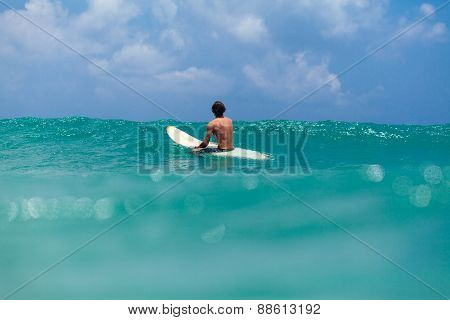 Unidentified Man Surfing In The Sea
