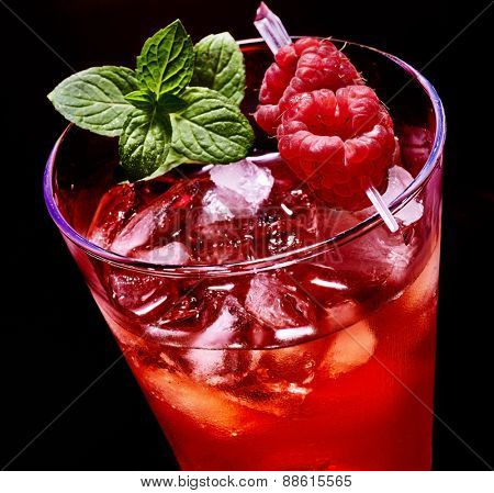 Ice cube red drink  with raspberry and mint leaf. Top view.