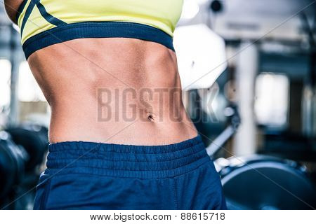 Closeup image of a strong woman's torso