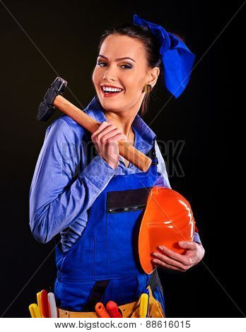 Woman in builder uniform with hammer. Blue coveralls.