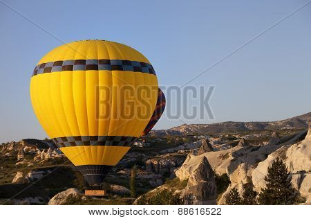 Hot Air Balloons In Mountains At Morning