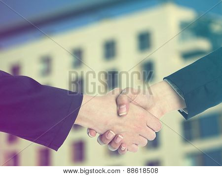 Handshake Handshaking and blured building in background