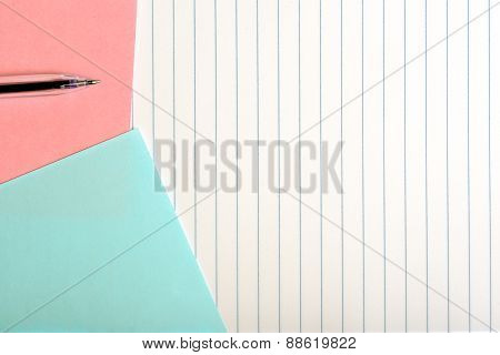 Colored Paper And Pen Isolated On Vertical Striped Background