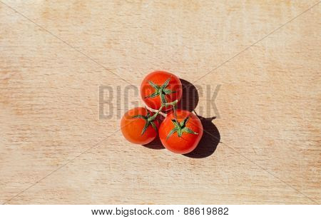 Tomatoes On The Wooden Background