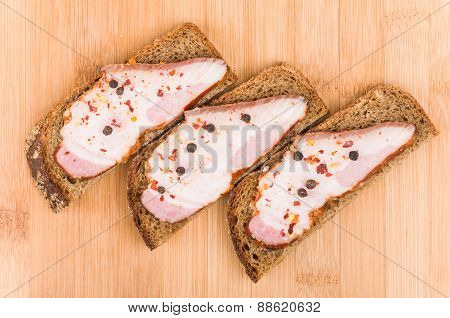 Three Sandwiches With Bacon And Pepper, Top View