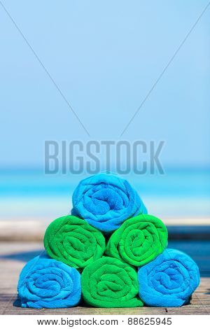 Close up of green and blue towels background the sea