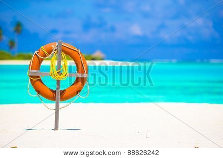 Lifebuoy ring on tropical white beach