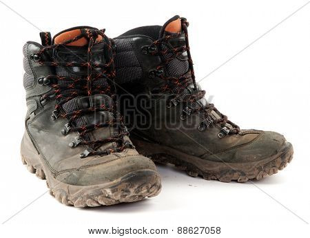 Isolated Pair of Dirty Boots on white background.
