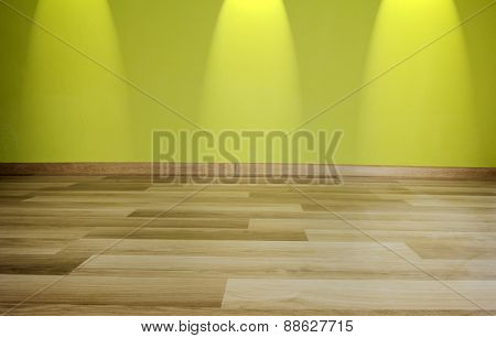 Empty room with green wall and wooden floor
