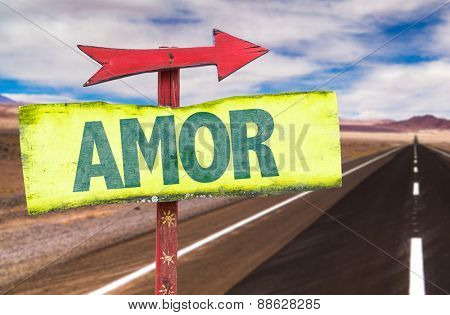 Love (in Portuguese) sign with road background