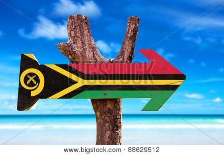 Vanuatu Flag wooden sign with beach background