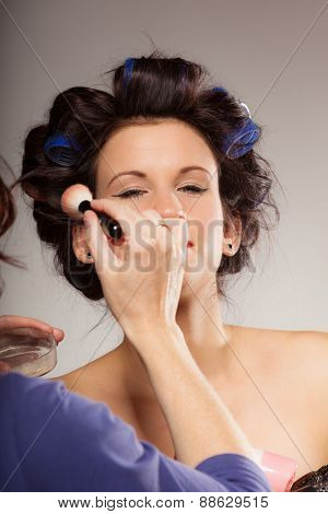 Makeup Artist Applying Powder