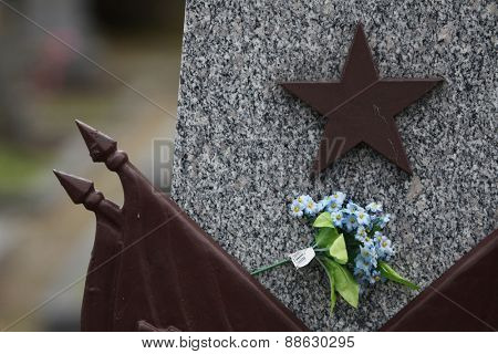 Red star at the Soviet War Memorial with graves of Soviet soldiers fallen in the last days of World War II at the Olsany Cemetery in Prague, Czech Republic.