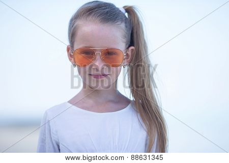 Portrait of adorable little girl during beach vacation