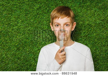 Boy breathing through inhalator mask
