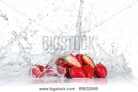 Fresh strawberries with water splash isolated on white