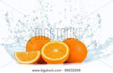 Fresh oranges with water splash isolated on white