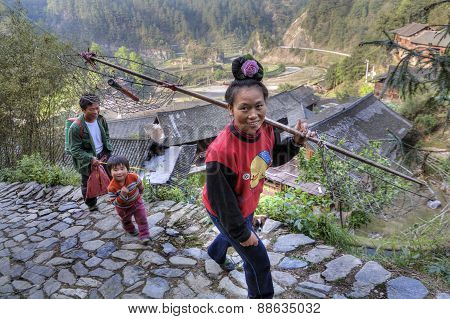Asian Woman Carrying A Yoke