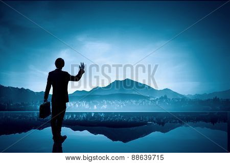 Rear view of businessman looking at picturesque nature landscape