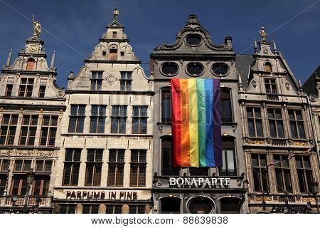 ANTWERP, BELGIUM - AUGUST 12, 2012: Rainbow flag on the medieval guild houses at the Grote Markt in Antwerp, Belgium.