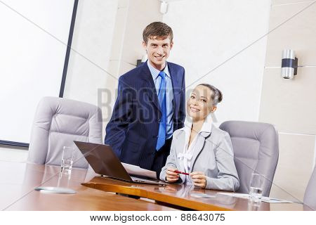 Young businessman showing lady boss business documents