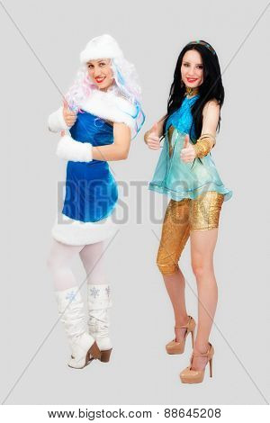 Two girls in studio on white