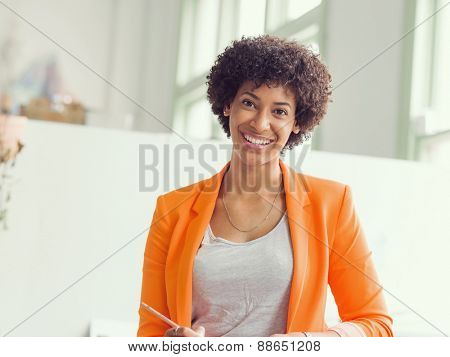 Portrait of young businesswoman in office