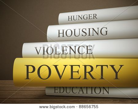 Book Title Of Poverty Isolated On A Wooden Table