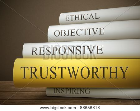Book Title Of Trustworthy Isolated On A Wooden Table
