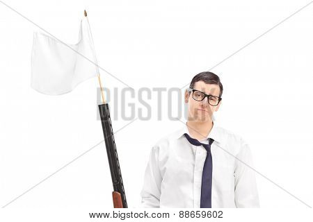 Sad guy holding a rifle with white flag attached on it isolated on white background