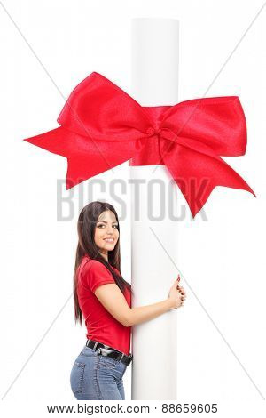 Young woman hugging a huge diploma isolated on white background