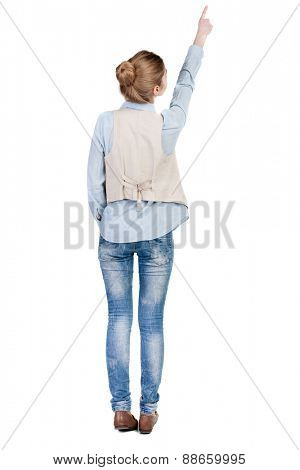 Back view of  pointing woman in vest. beautiful girl. Rear view people collection.  backside view of person.  Isolated over white background.