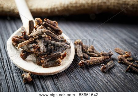 Pile Cloves On Wooden Spoon