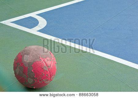 Old Red Ball At Corner Of Futsal Field