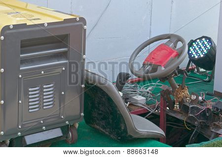 Yellow Gasoline Generator On Old And Rust Car
