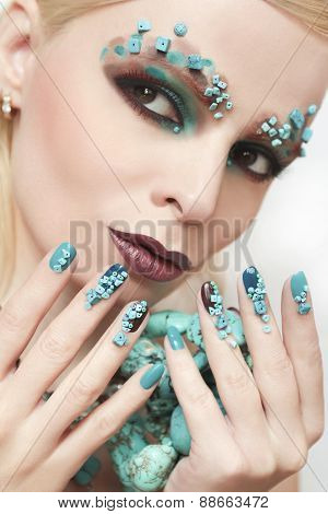 Manicure and makeup with beads.
