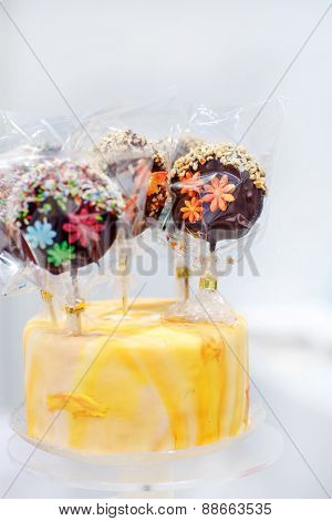 Wedding Cake With Chocolate Candy On Top.