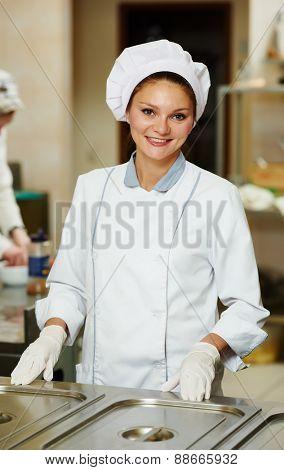 Female Chef portrait in hotel or restaurant kitchen