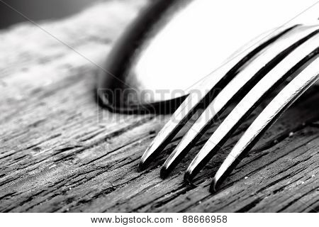 Spoon And Fork On Wooden Background Macro