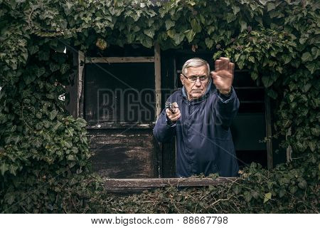 Senior Man With A Gun Protecting Property