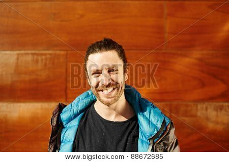 Close Up Portrait  Happy Handsome Young Male Model Smiling At Camera Standing At The Wall Under The
