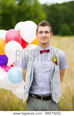 Happy Young Groom Holding In Hands Colorful Latex Balloons